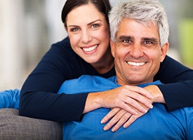 Man with All-On-4 on couch with his spouse
