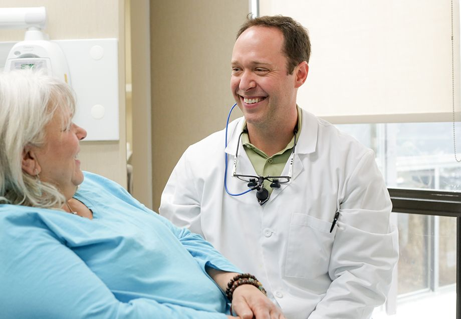 Dr. Robison smiling at patient