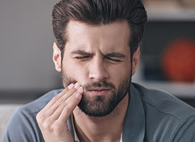 man with beard in severe pain