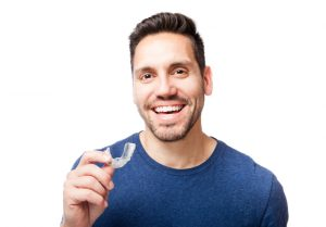 Invisalign clear aligners from Canton dentist, Dr. J. D. Robison, correct crooked smiles invisibly and quickly with comfort. Learn treatment details here.