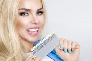 woman holding veneers