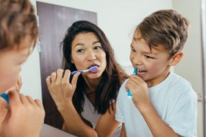 parent and child brushing their teeth